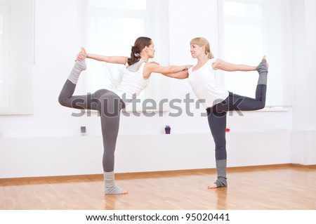 Group of sport women in the gym centre doing stretching fitness exercise. Yoga - stock photo