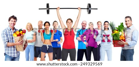 Group of sportive people with vegetables. Diet and fitness. - stock photo