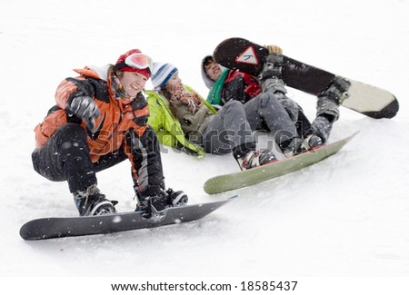 Group of sports teenagers snowboarders in mountains in snow