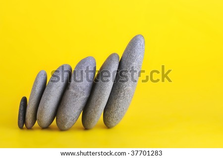group of stones leaning to right - stock photo
