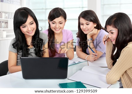 group of student girls studying together with laptop in library