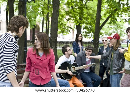 Group of student on weekend. Music. Problem - stock photo