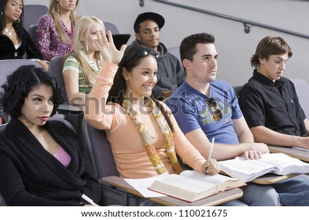 Group of student studying together in classroom - stock photo