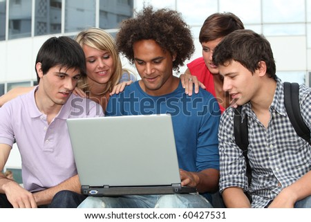 Group of student with laptop computer - stock photo
