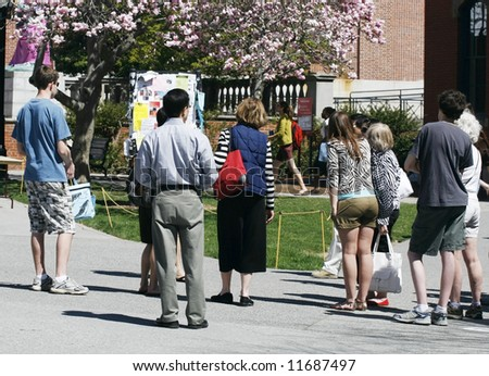 group of students and parents taking college tour - stock photo