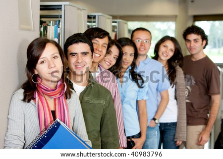 Group of students at a library smiling