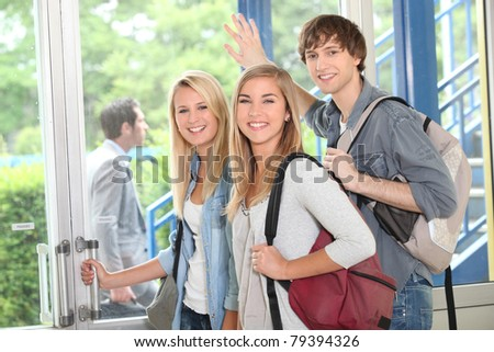 Group of students at college entrance - stock photo
