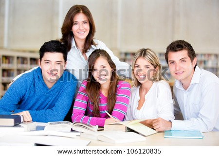 Group of students at the library looking happy - stock photo