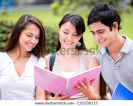 Group of students at the university looking happy - stock photo
