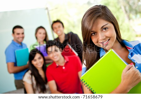 Group of students at the university with notebooks