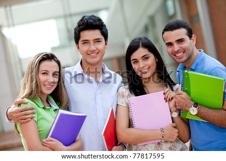 Group of students at the university with notebooks - stock photo
