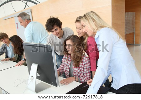 Group of students attending training course at school - stock photo