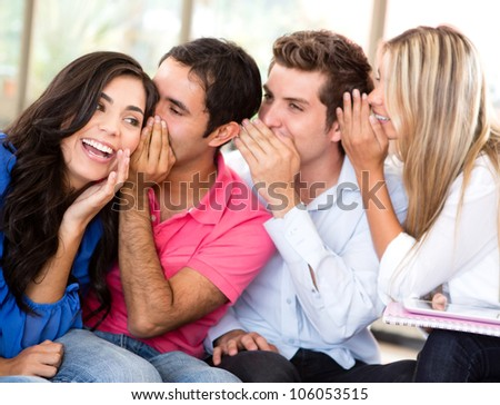 Group of students gossiping at the university - stock photo