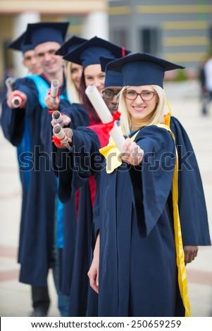 group of students graduates - stock photo