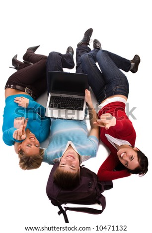 group of students having fun, laying on white, doing home work - stock photo