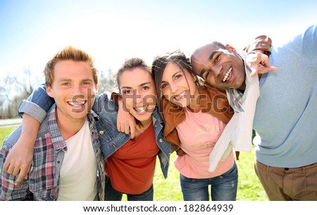 Group of students having fun outside college campus - stock photo