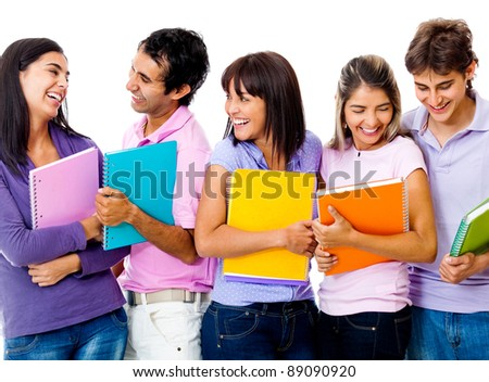 Group of students holding notebooks and smiling - isolated over a white background - stock photo