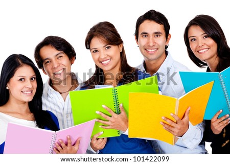 Group of students holding notebooks - isolated over a white background - stock photo
