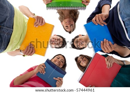 Group of students in a circle holding notebooks - isolated over white - stock photo