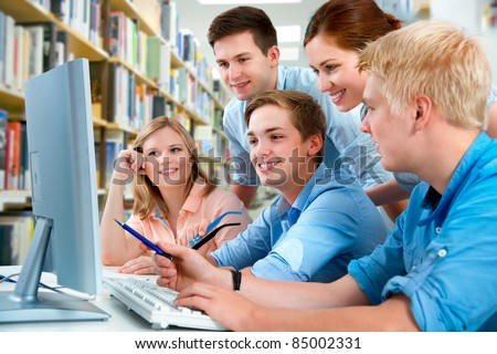 group of students in a college library - stock photo
