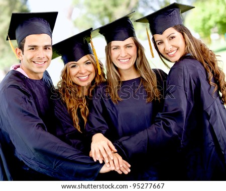 Group of students in their graduation with hands together - teamwork concepts - stock photo