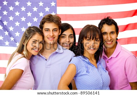 Group of students learning English as a foreign language with the American flag on the background - stock photo