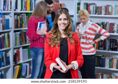 Group of students learning in the library and enjoy it - stock photo