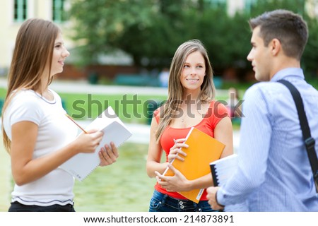 Group of students outdoor talking together - stock photo