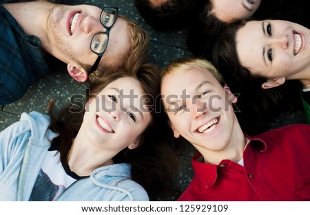 Group of Students outside on the ground smiling - stock photo
