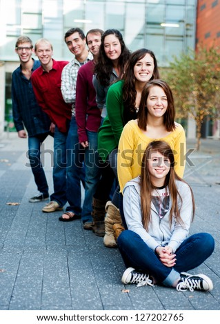 Group of students outside smiling together - stock photo