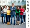 Group of students outside together serious - stock photo