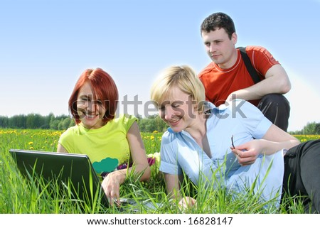 group of students relaxing outdoors - stock photo