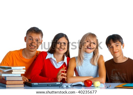Group of students sit at the desk and smile on white background - stock photo