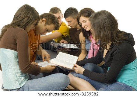 Group of students sitting and reading the books. White background.