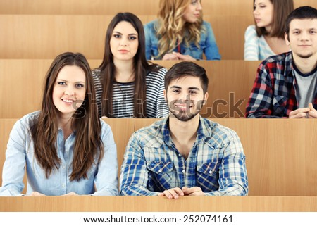 Group of students sitting in classroom - stock photo