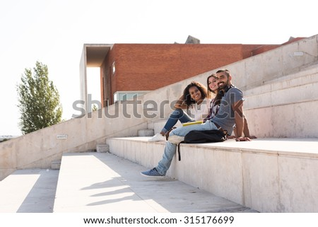 Group of students sitting on school stairs