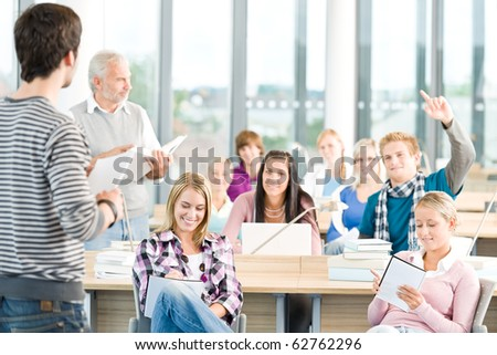 Group of students study in classroom at high school with professor - stock photo