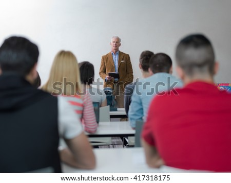 group of students study with senior professor in modern school classroom on creative class - stock photo