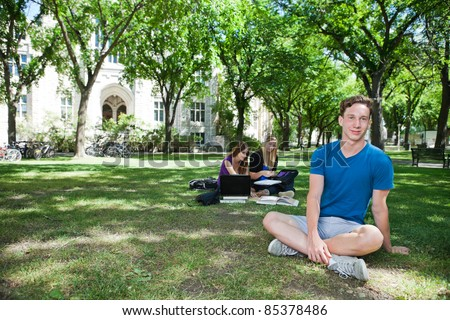 Group of students studying at college campus - stock photo