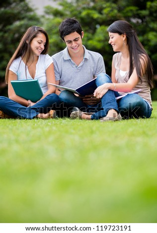 Group of students studying at the park - stock photo