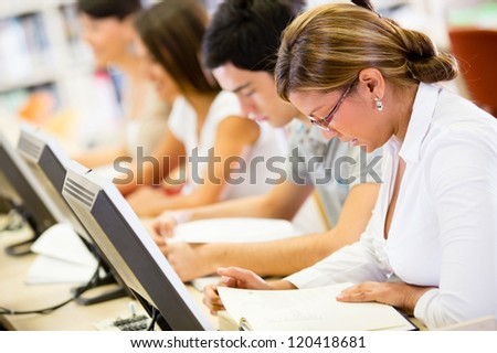 Group of students studying in a computer room - stock photo