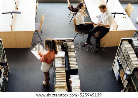 Group of students studying in a library and educating themselves