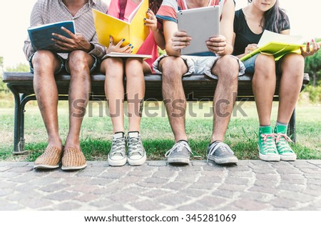 Group of students studying outdoor. Concept about education, people and friendship - stock photo