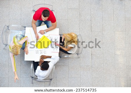 group of students studying together in a classroom - stock photo