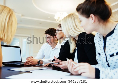 Group of students studying using a laptop