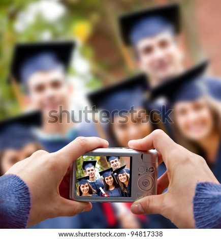 Group of students taking a picture in their graduation - stock photo