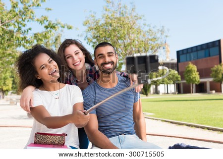 Group of students taking a selfie in school campus - stock photo