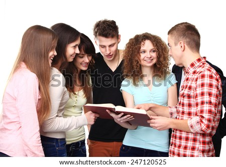 Group of students talking and holding notebooks - stock photo
