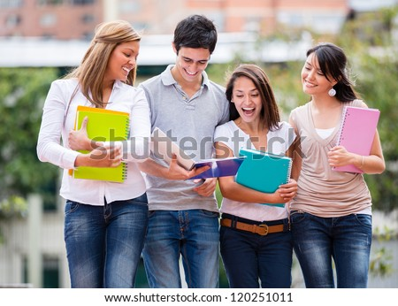 Group of students walking at the university - stock photo