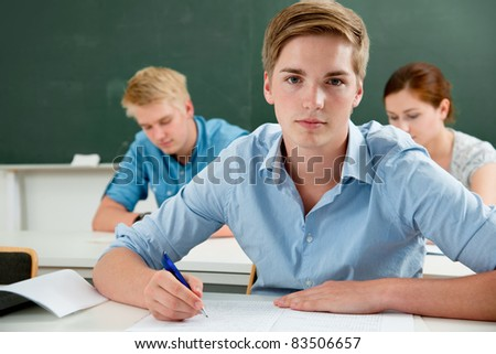group of students  while studying in classroom - stock photo